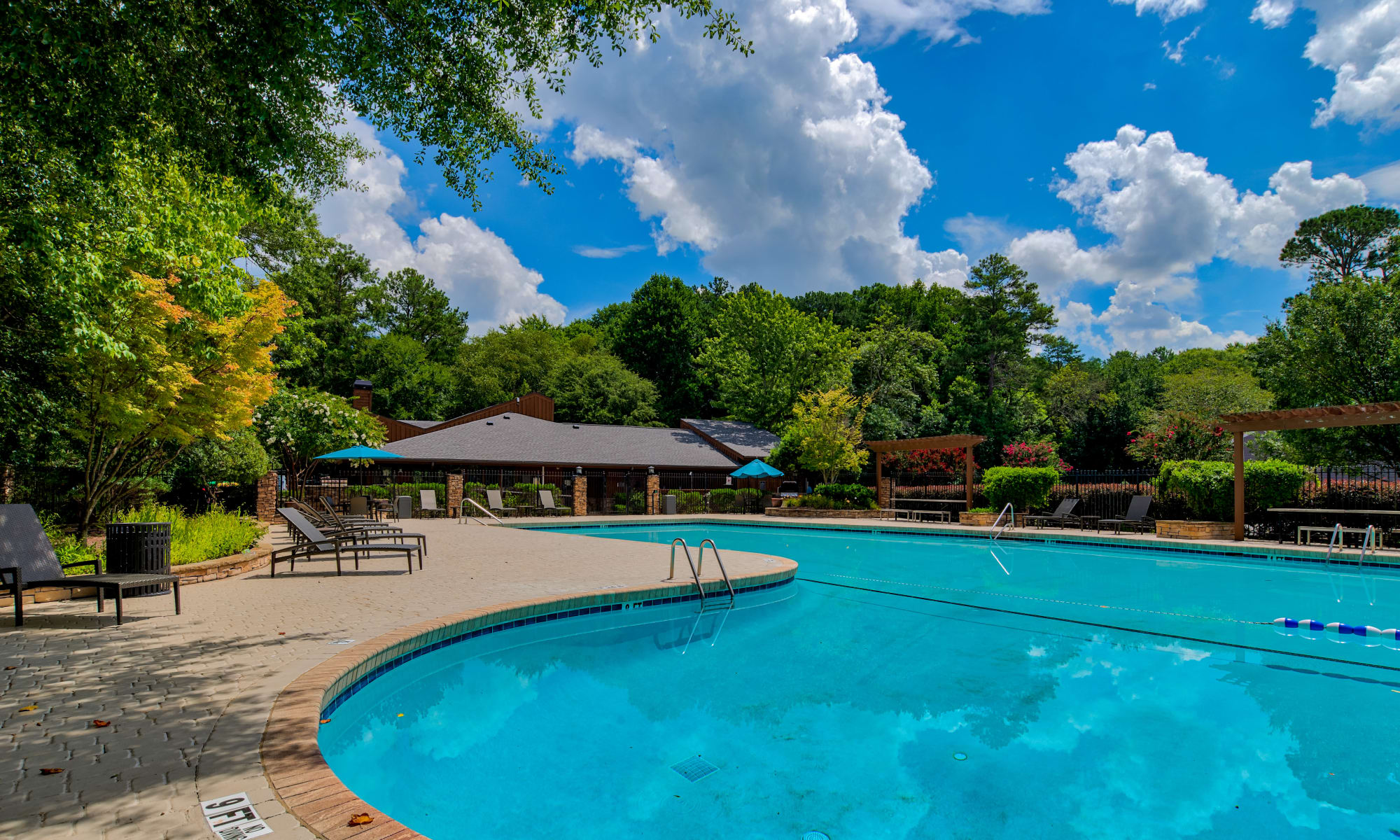 Swimming pool at The Lodge on the Chattahoochee Apartments in Sandy Springs, Georgia