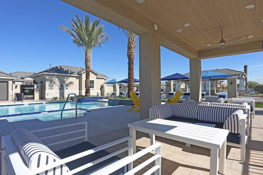 Beautiful swimming pool with nearby lounge seating at Christopher Todd Communities On Greenway in Surprise, Arizona