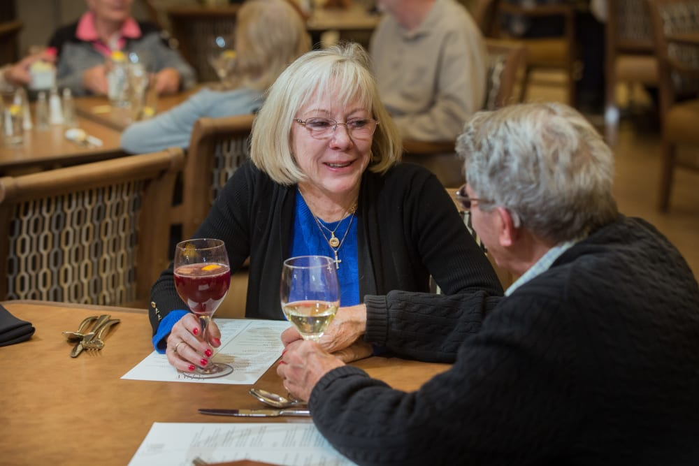 Two residents having drinks at Touchmark at Mount Bachelor Village in Bend, Oregon