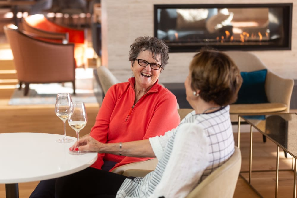 Two residents having drinks at Touchmark on West Century in Bismarck, North Dakota