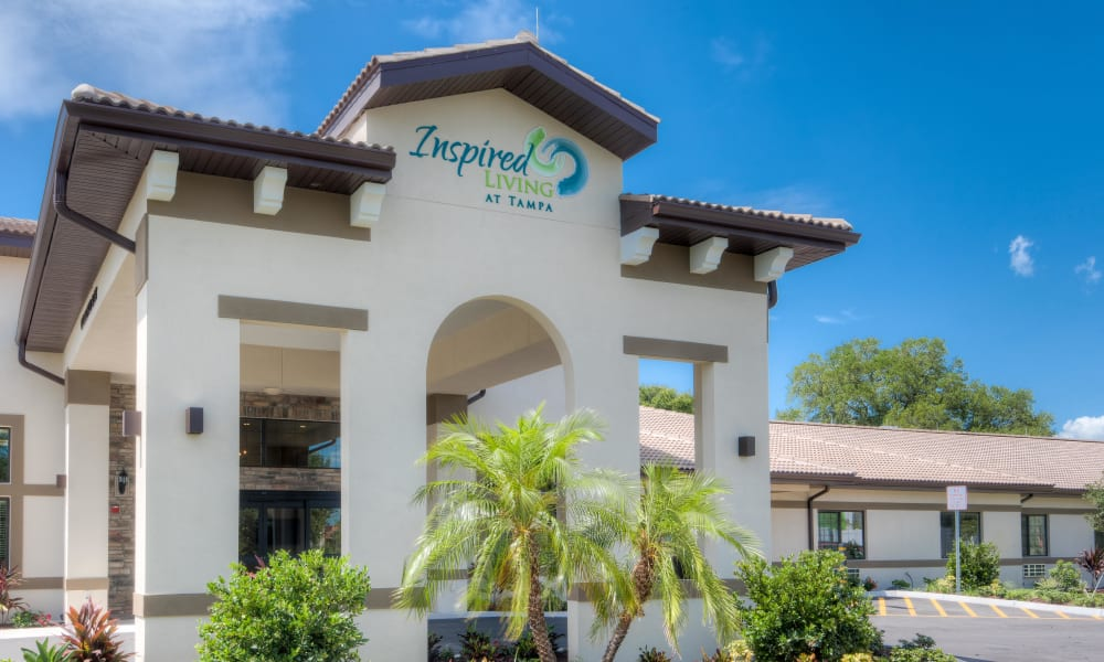 Exterior view of main entrance at Inspired Living Tampa in Tampa, Florida