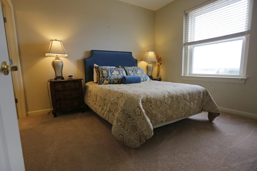 A furnished bedroom at The Chamberlin in Hampton, Virginia