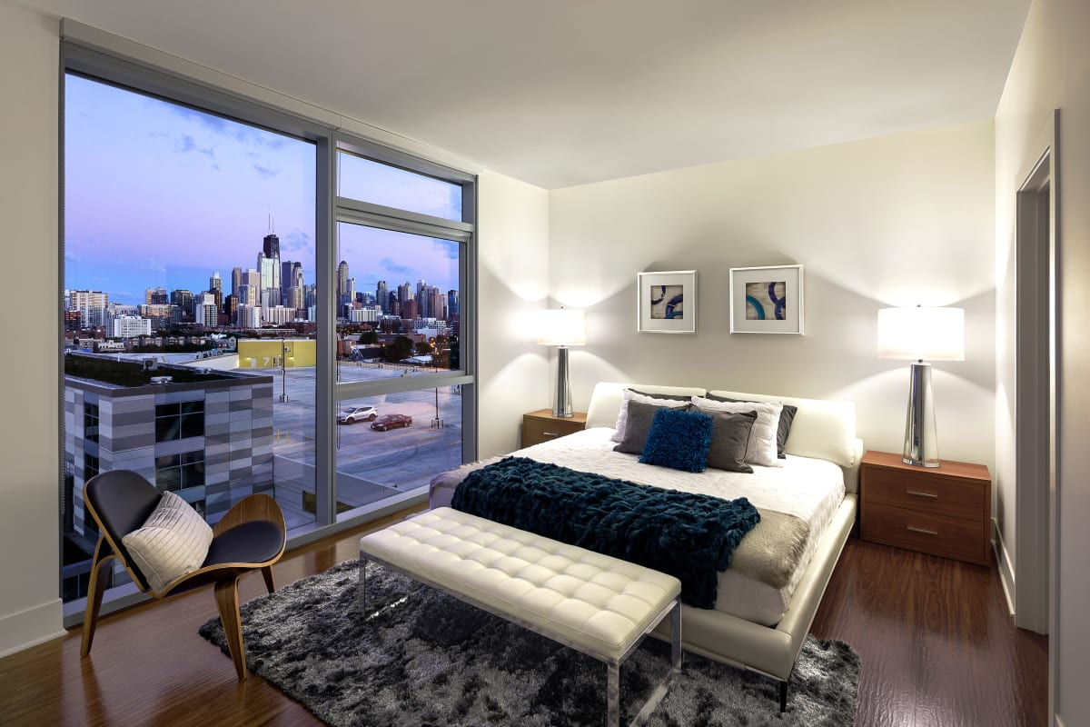 Spacious master bedroom with a back porch access at The Residences at NEWCITY in Chicago, Illinois