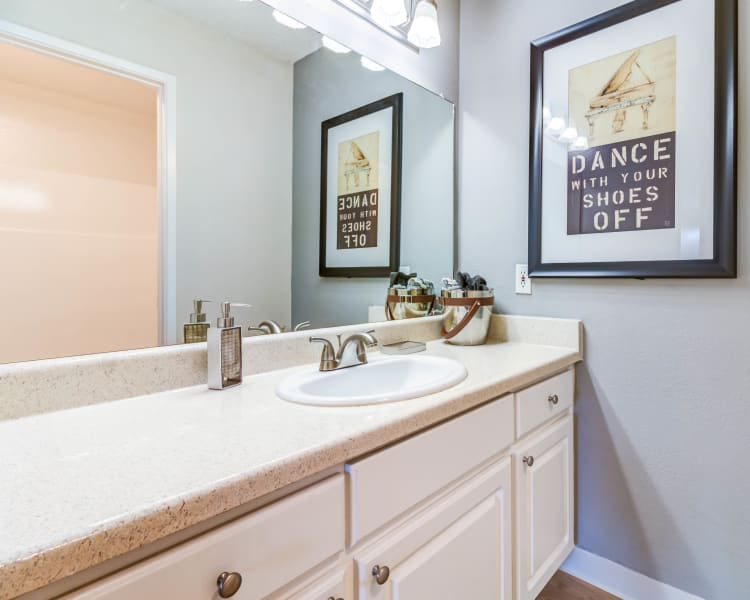 Bathroom with a large vanity mirror and ample counter space in a model home at The Landmark Apartment Homes in Sunnyvale, California