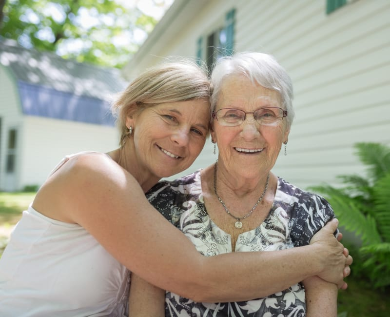A volunteer hugging a resident at Ebenezer Ridges Campus in Burnsville, Minnesota.