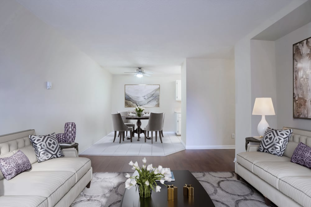 Inviting living room at Lakeview Mews in Calgary, AB