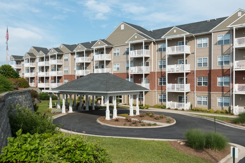 The driveway and exterior of The Harmony Collection at Roanoke - Independent Living in Roanoke, Virginia