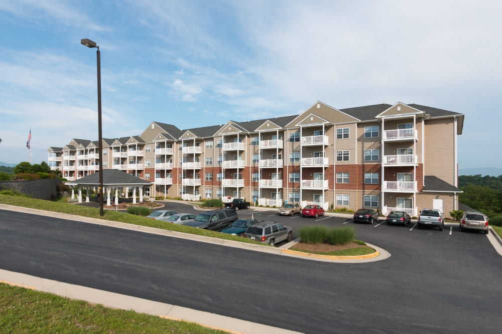 The parking lot and exterior of The Harmony Collection at Roanoke - Independent Living in Roanoke, Virginia