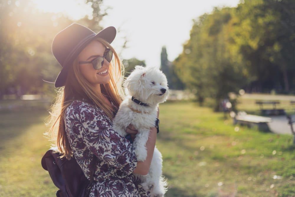Resident holding her dog at Linden Audubon Park in Orlando, Florida