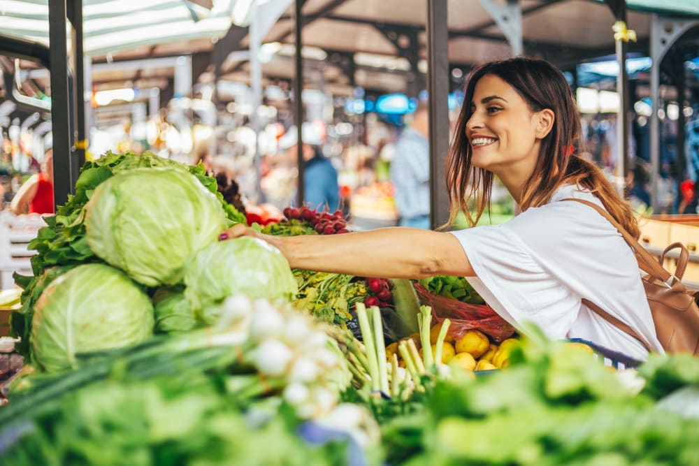 Woman shopping at the farmers market in Austin, Texas near Residences at The Triangle