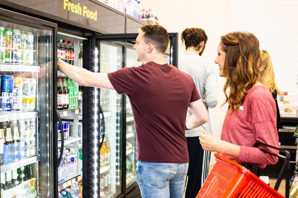 Woman shopping at convenient store at Mosaic Dallas