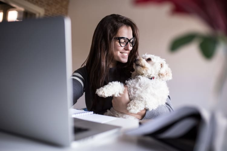 Resident and her dog loving their new home at Watergate Pointe in Annapolis, Maryland
