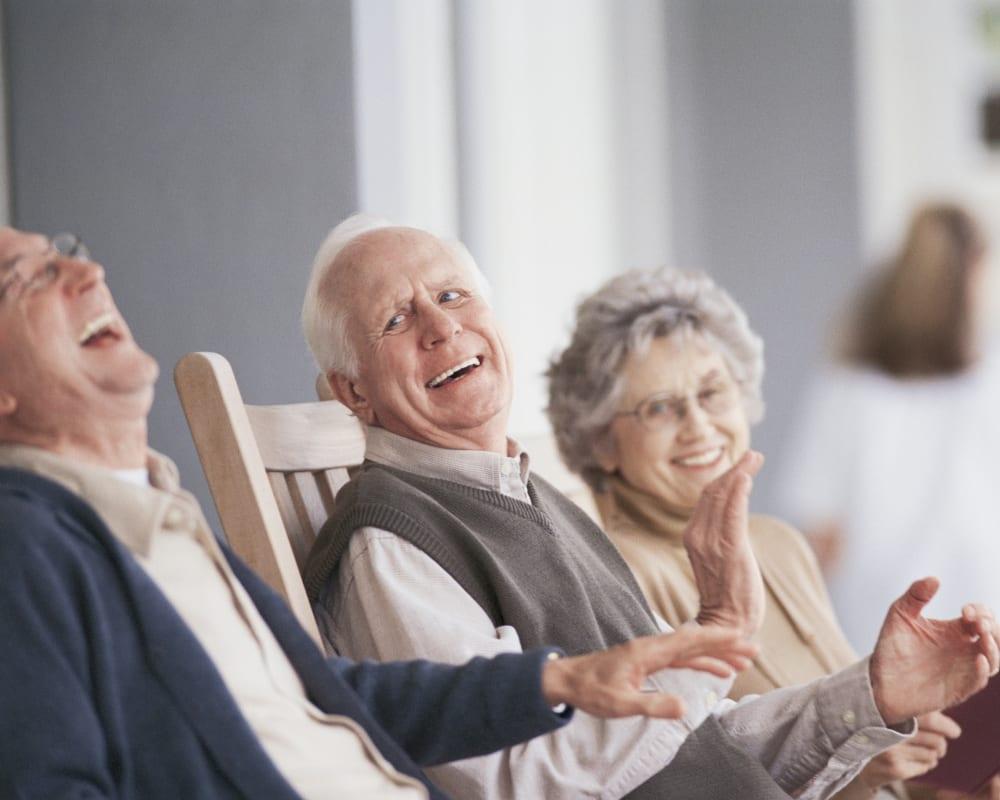 Residents enjoy chatting on the deck at The Preserve of Roseville in Roseville, Minnesota.