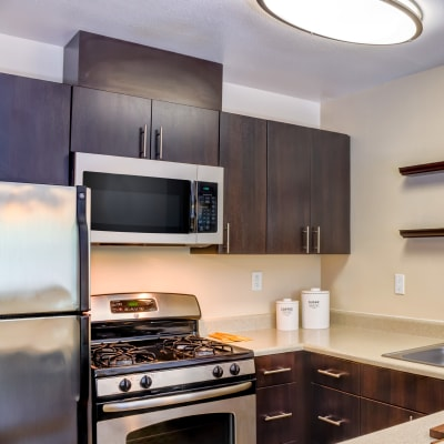 Modern kitchen with stainless-steel appliances in a model home at Sofi Belmont Hills in Belmont, California