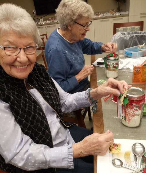 Residents at Burien making cookie jar craft.