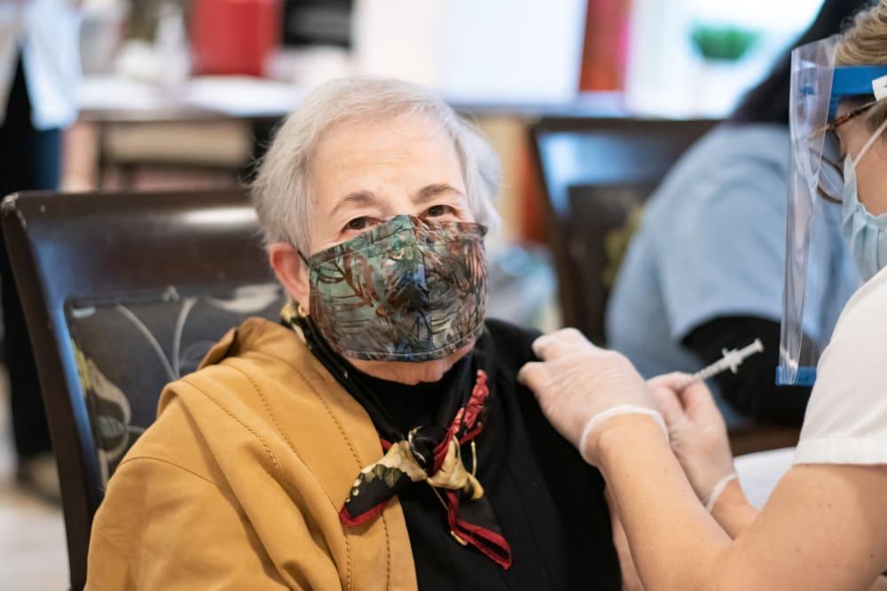 senior woman receiving a vaccine