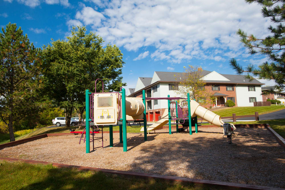 Children's playground at Carriage Hill Apartments in Pittsford, NY