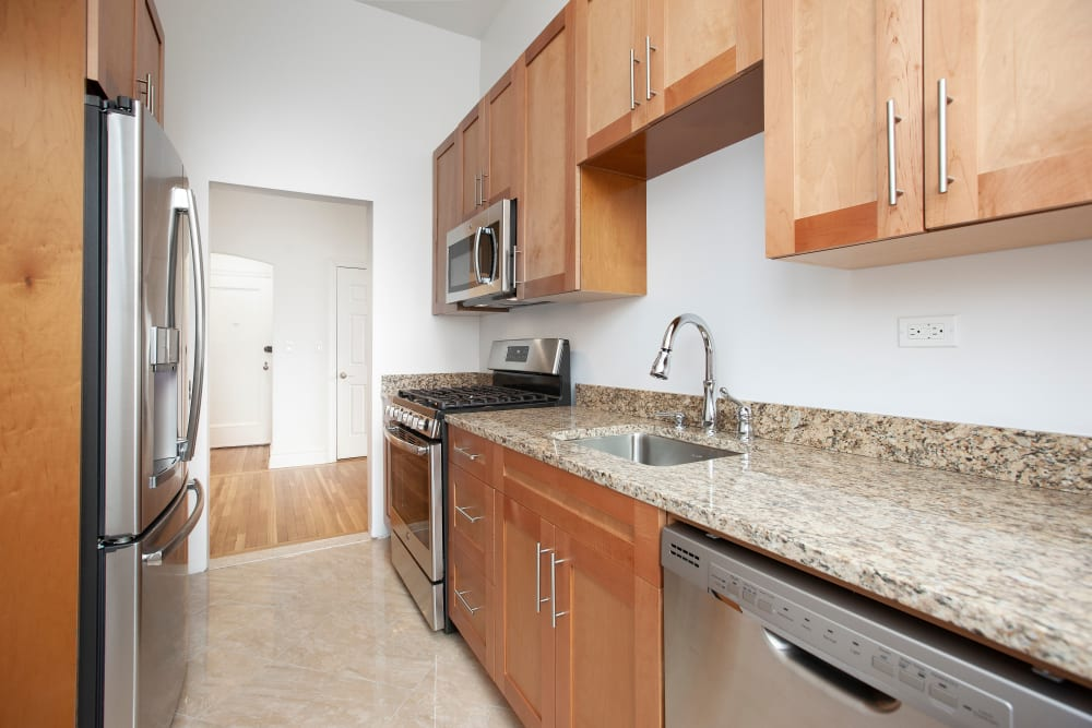 Kitchen with granite counter tops at The Sutton Collection in New York, New York