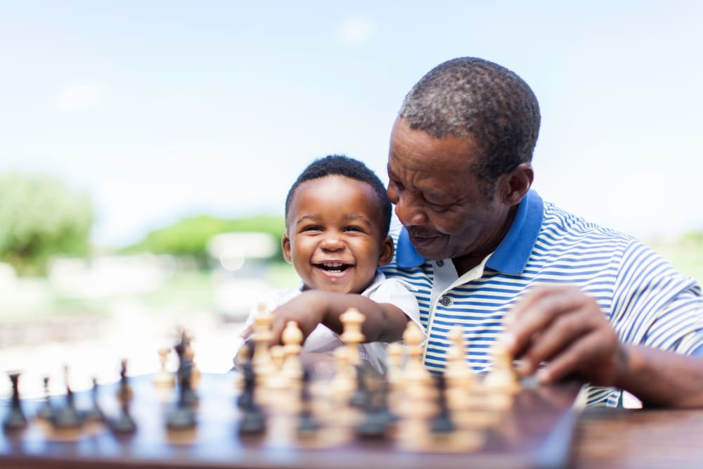 A resident playing chess at Alura By Inspired Living in Rockledge, Florida.
