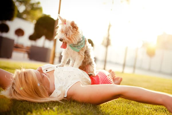 Owner plays with her dog at Parcside in College Station, Texas