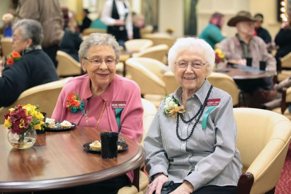 Two happy residents at Glenmoore Gracious Retirement Living in Happy Valley, Oregon
