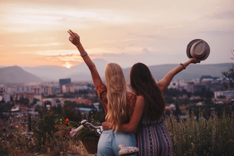 Two friends celebrating the sunset near Ten Wine Lofts in Scottsdale, Arizona