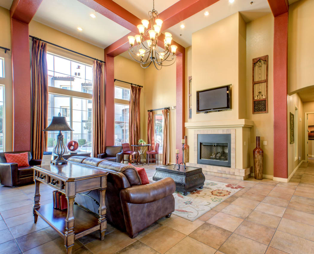 Beautifully appointed resident clubhouse with a fireplace and flatscreen TV at Waterford at Peoria in Peoria, Arizona
