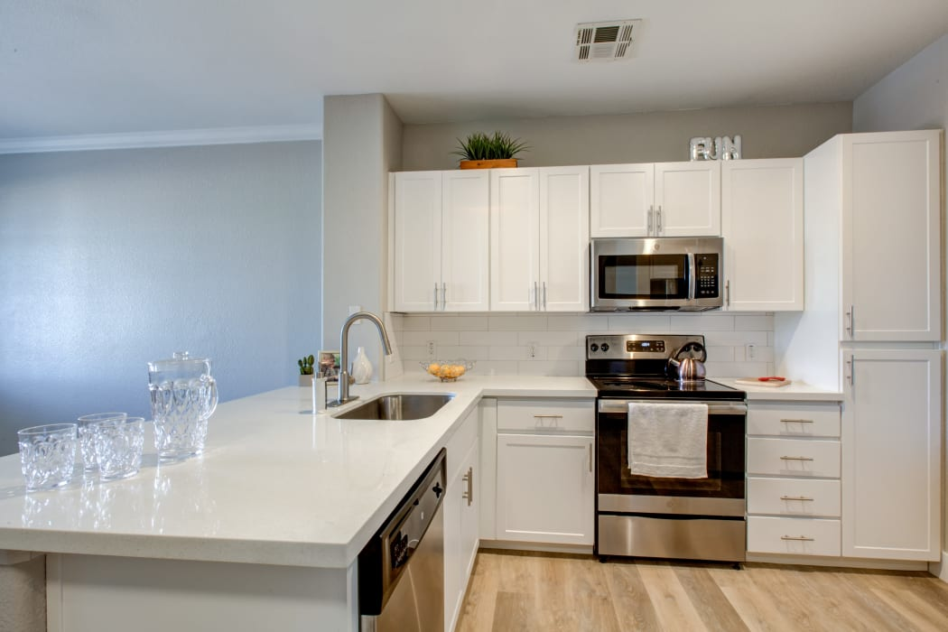 Gourmet kitchen with granite countertops in apartment home at Waterford at Peoria in Peoria, Arizona