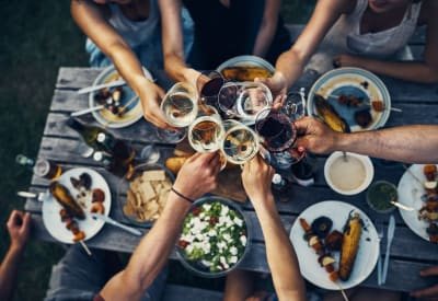 Residents at their favorite restaurant raising a toast to the good life at Arbrook Park Apartment Homes in Arlington, Texas