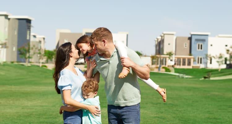 Family playing outside at BB Living at Eastmark in Mesa, Arizona