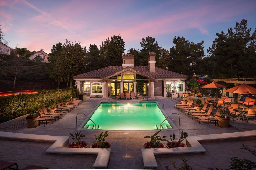 Beautiful swimming pool at dusk at Paloma Summit Condominium Rentals in Foothill Ranch, California
