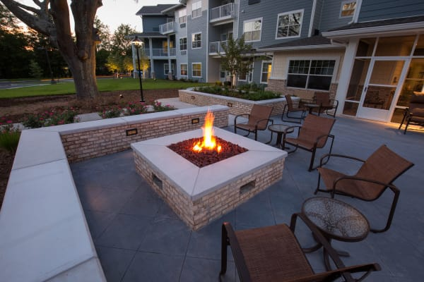 Outdoor patio with a fireplace at Springwood Landing Gracious Retirement Living in Vancouver, Washington
