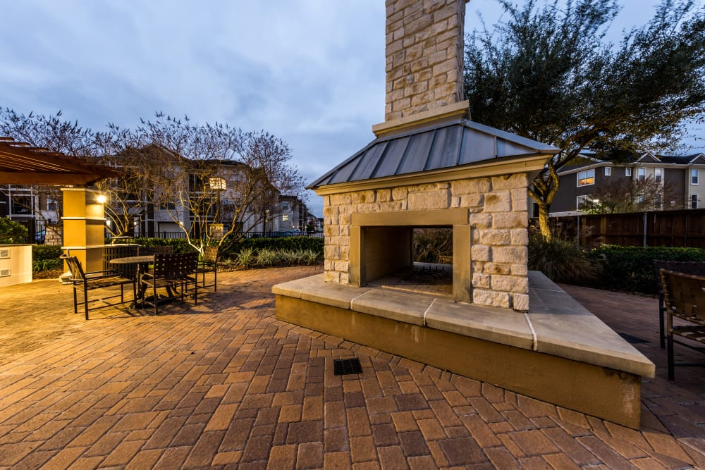 Water feature next to pool at Marquis at The Woodlands in Spring, Texas