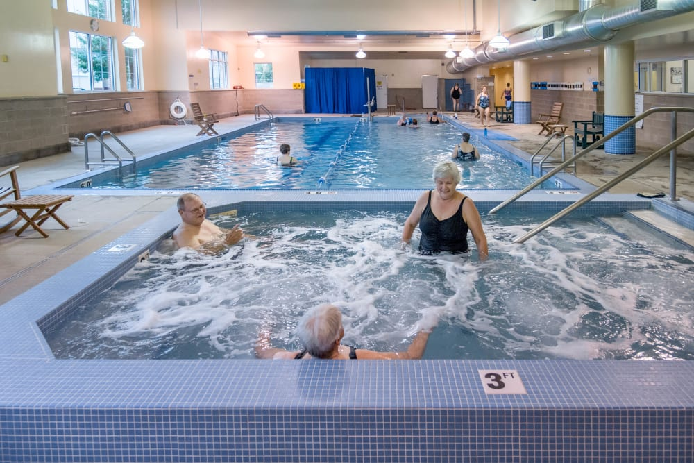 Residents in a hot tub at Touchmark on West Century in Bismarck, North Dakota