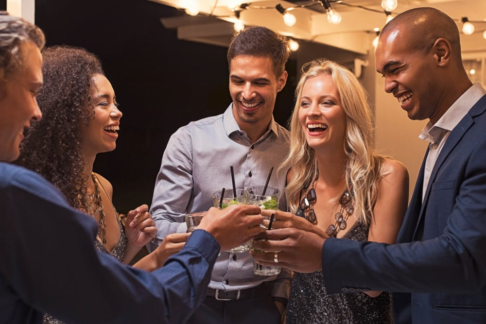 Resident friends enjoying drinks and conversation at the clubhouse at Canyon View in Las Vegas, Nevada