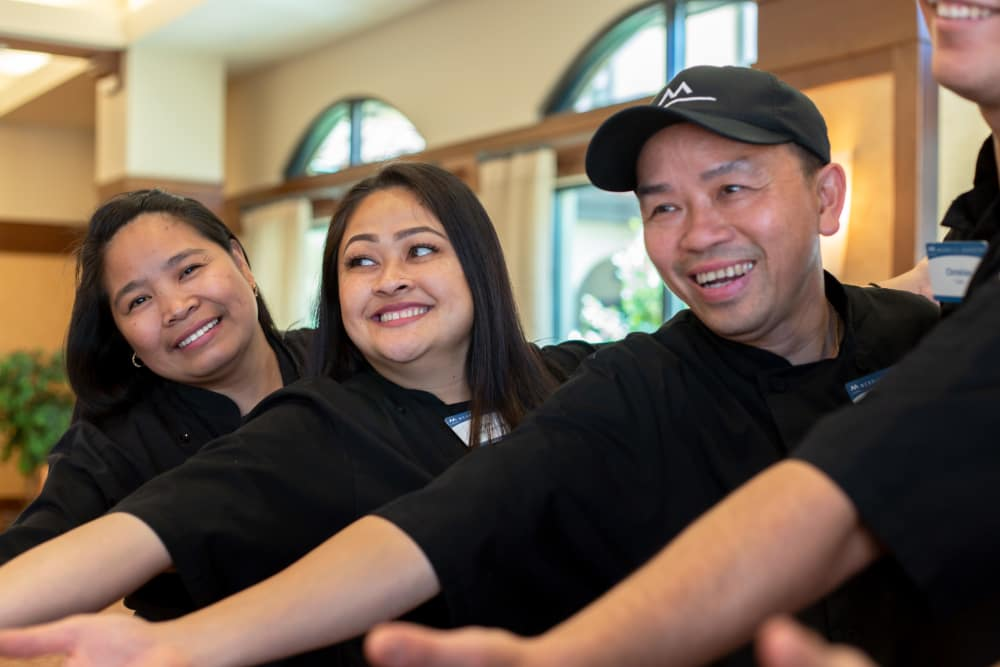 Dining team members serving at our senior living community in Campbell, CA