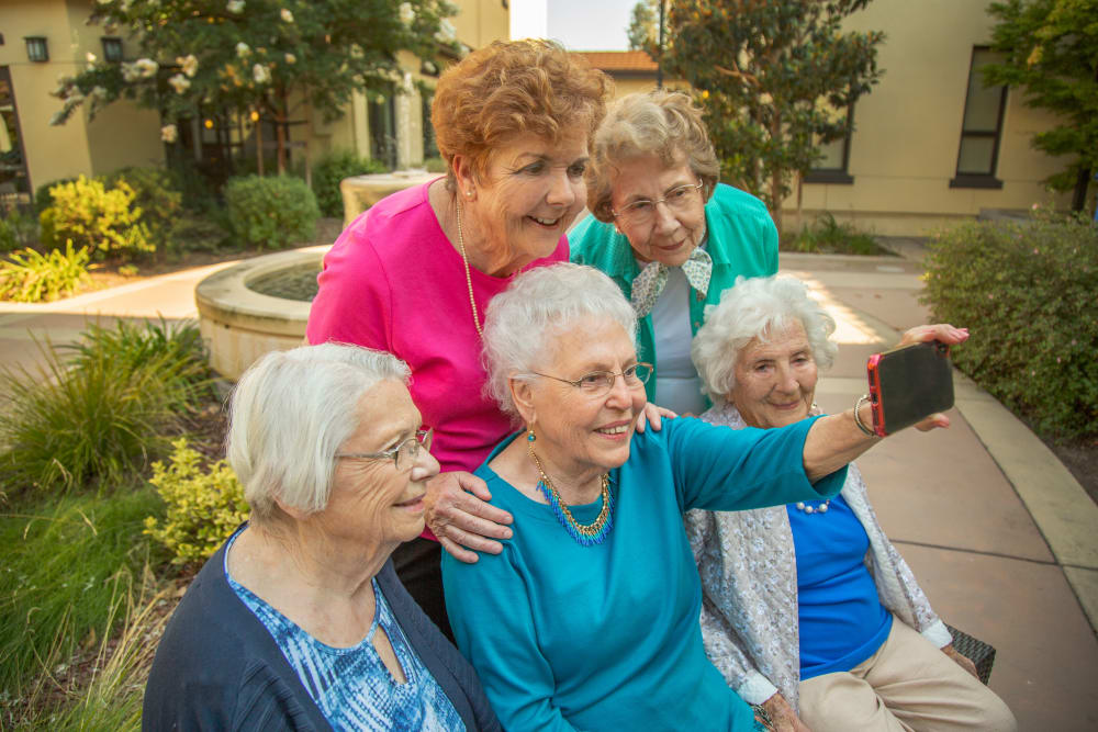 Senior ladies taking a selfie at Merrill Gardens at Campbell