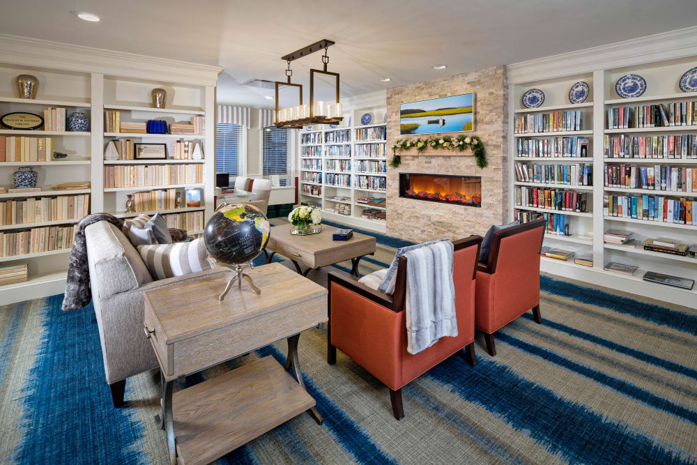 Living room filled with books at Maplewood Senior Living in Westport, Connecticut