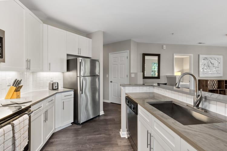 Gorgeous gourmet kitchen with stainless-steel appliances and hardwood floors in a model home at The Lena Luxury Residences in Raritan, New Jersey