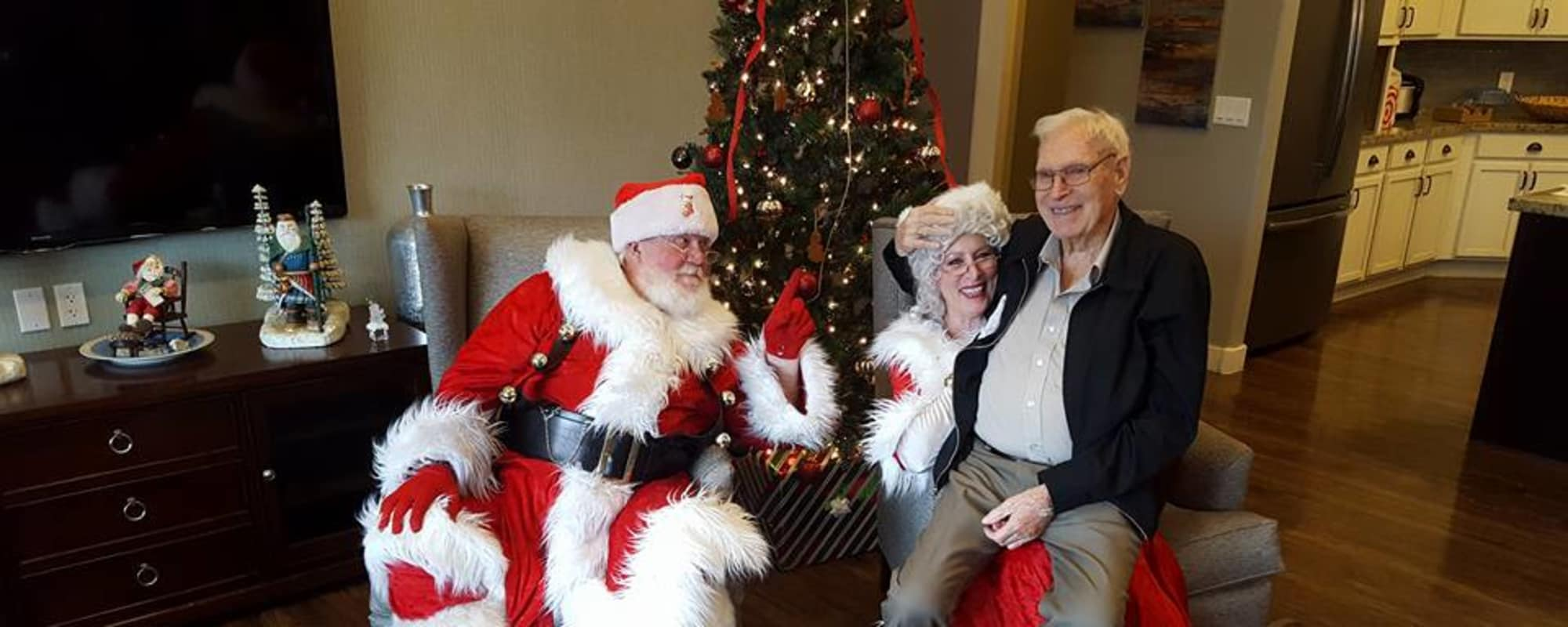 Seniors sitting with Santa at Hacienda Del Rey in Litchfield Park, Arizona