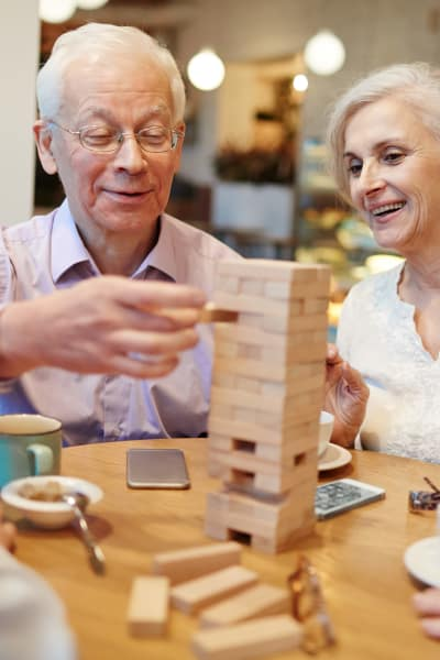 Senior residents playing jenga at Evergreen Court in North Bend, Oregon