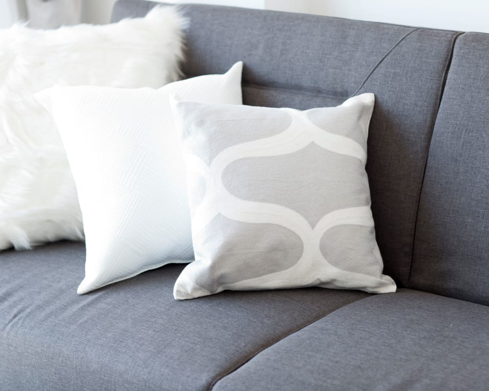 Throw pillows on a couch at Park Trail Apartments in Shelbyville, Tennessee