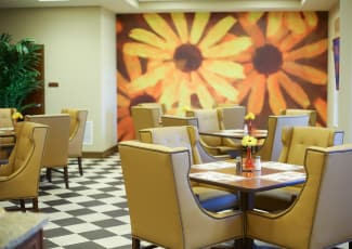 Interior view of bright and cheery casual dining area at Merrill Gardens at Solivita Marketplace in Kissimmee