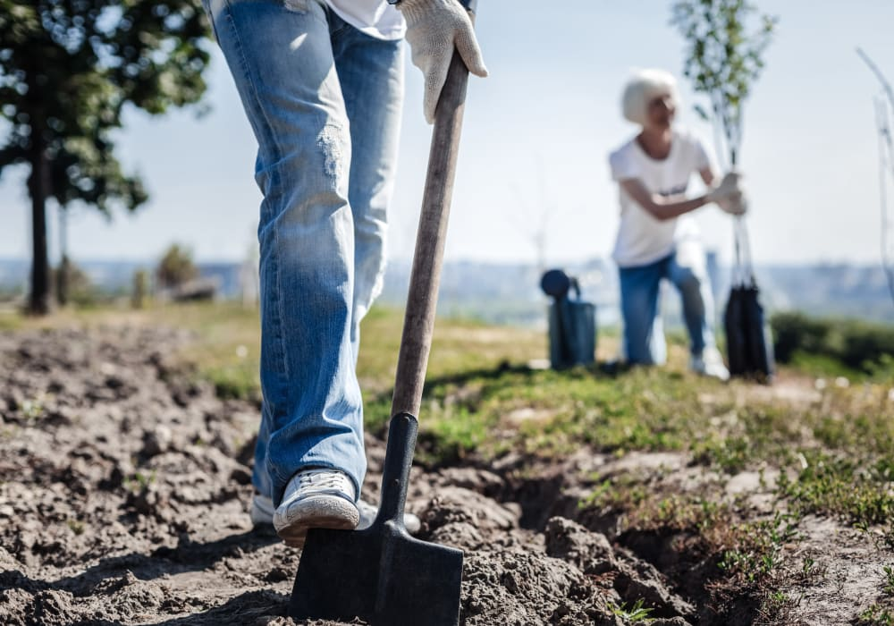Employees breaking ground at a Habitat for Humanity project sponsored by American Capital Group in Bellevue, Washington
