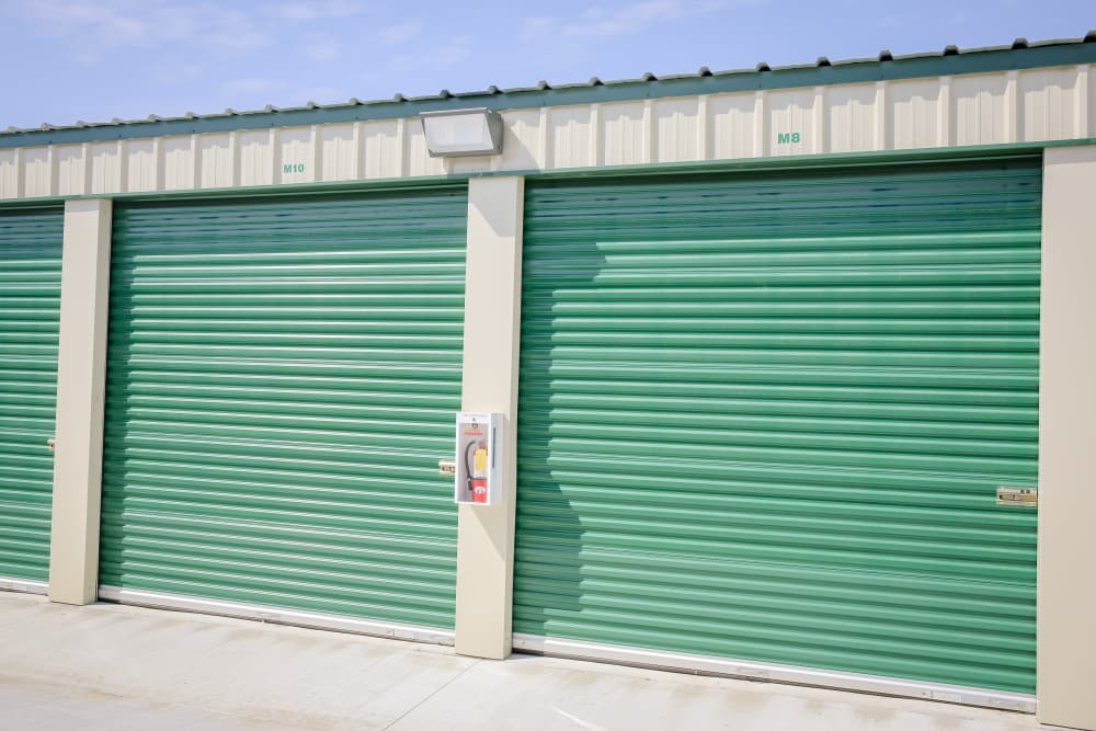 Outdoor units with green doors at Stor It Self Storage in Porterville, California