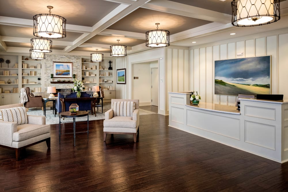 Clubhouse with hardwood flooring at Maplewood Senior Living in Westport, Connecticut
