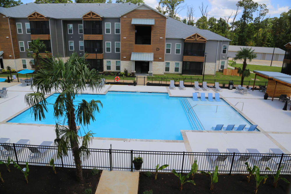 Apartments with a swimming pool at North Village Apartments in Ruston, Louisiana