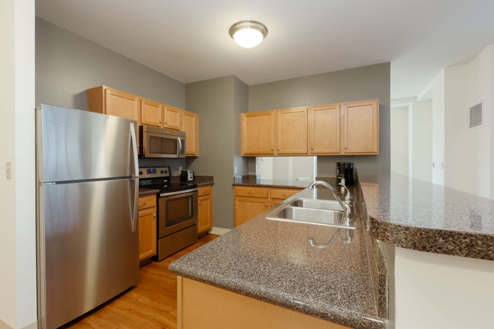 Gorgeous counter tops in apartment at Kimball Towers at Burlington in Burlington, Massachusetts