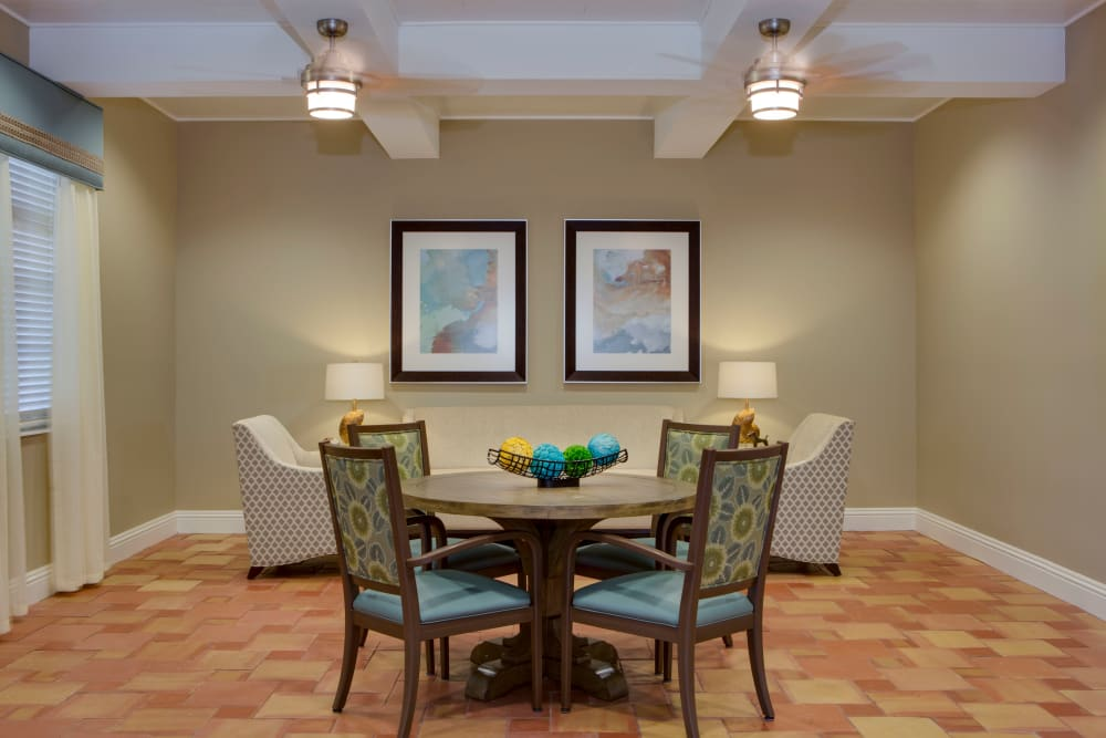 Lounge with tables and seating at Beach House Assisted Living & Memory Care Naples in Naples, Florida