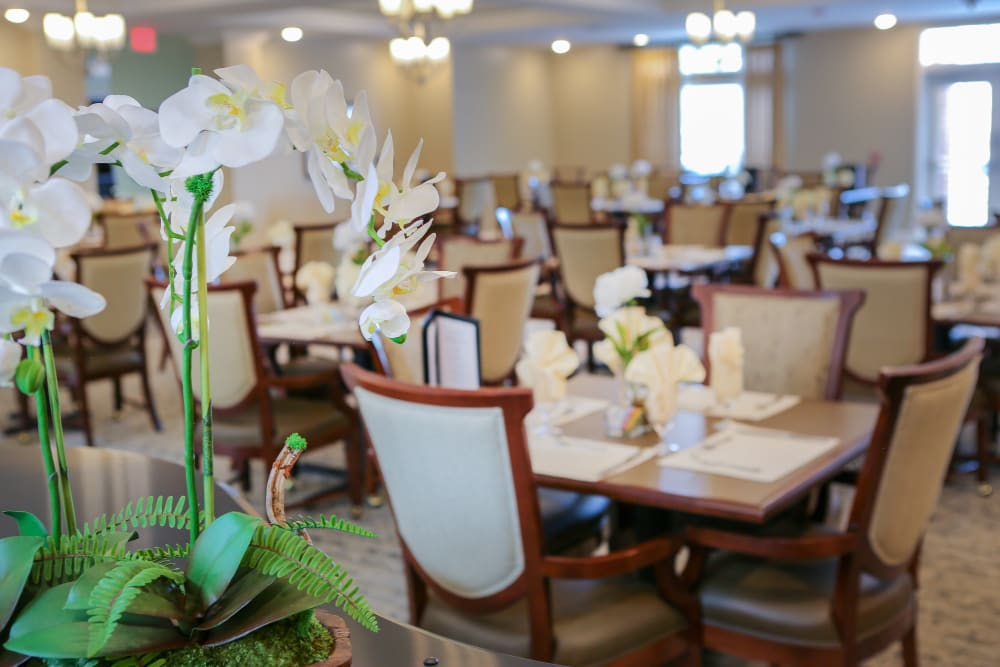 Well decorated dining room tables at Harmony at Spring Hill in Lorton, Virginia